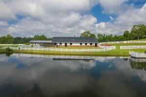 Tract 1 - 153.85 +/- Acres w/ Custom Home w/ Equestrian Barn